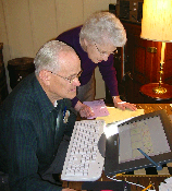 Photo of two grandparents using a computer