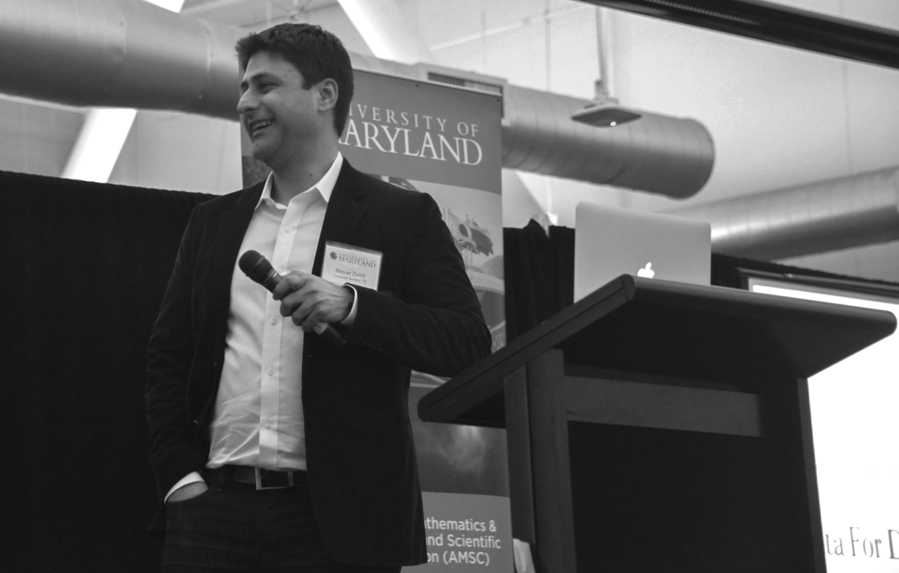 photo of Zoosk co-founder Shayan Zadeh addresses Bay Area alumni in Palo Alto, CA during an event in March, 2014