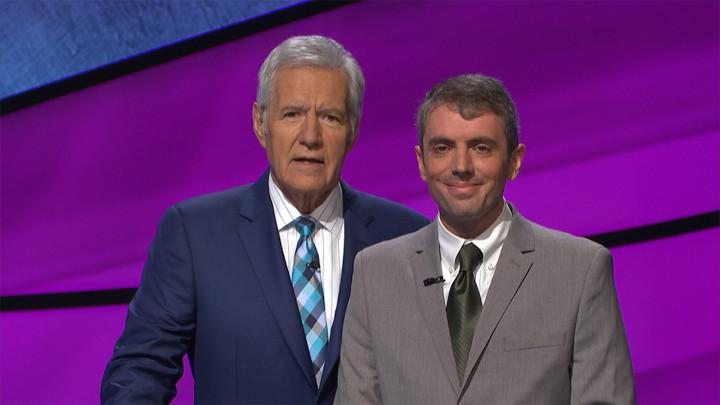photo of Boyd-Graber with Jeopardy host Alex Trebek